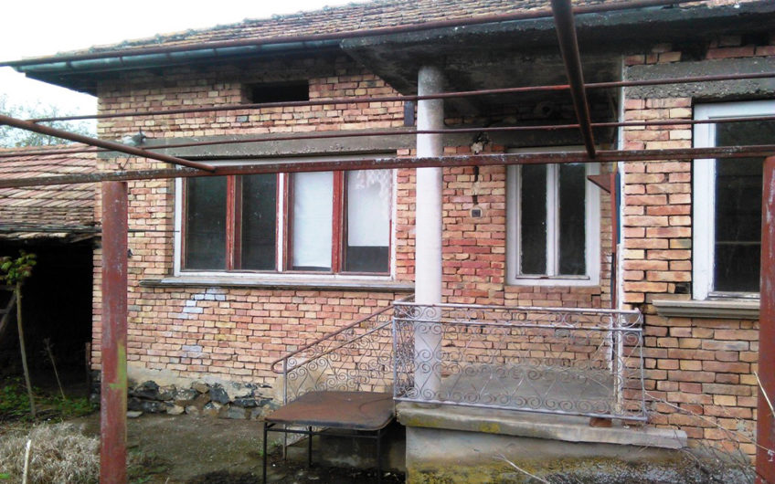 ONE-STOREY BRICK HOUSE WITH AN EXTERNAL FURNACE